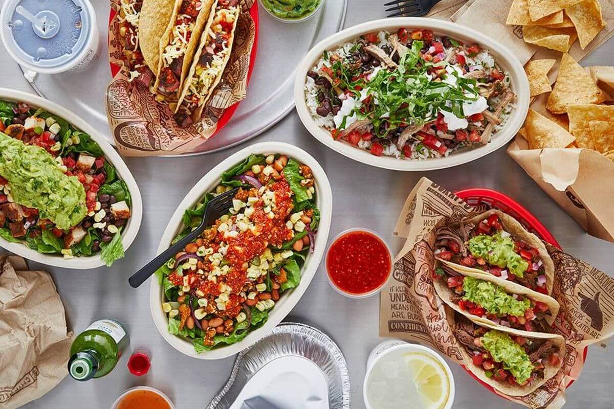 Top View of Dinning Table with Tacos, Taco Salads, and Tortilla Chips